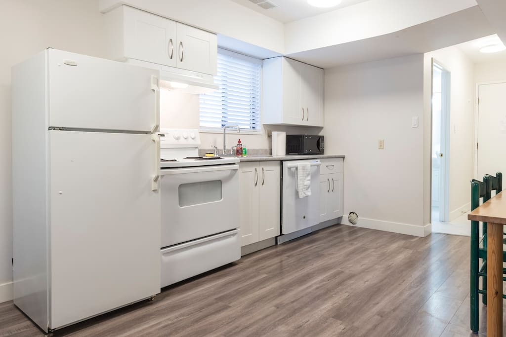 Full Kitchen with dishwasher, fridge and microwave
