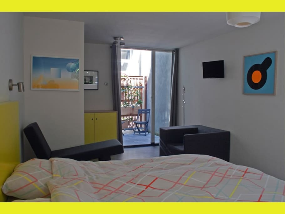 The 'yellow' room is an attractive, quiet bedroom with double bed, sofa and armchair.