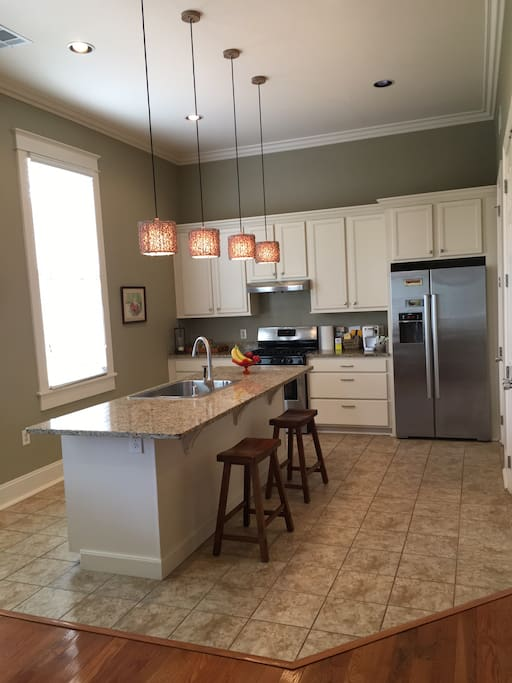 Open Kitchen with Bosch stainless appliances, opens to the dining area
