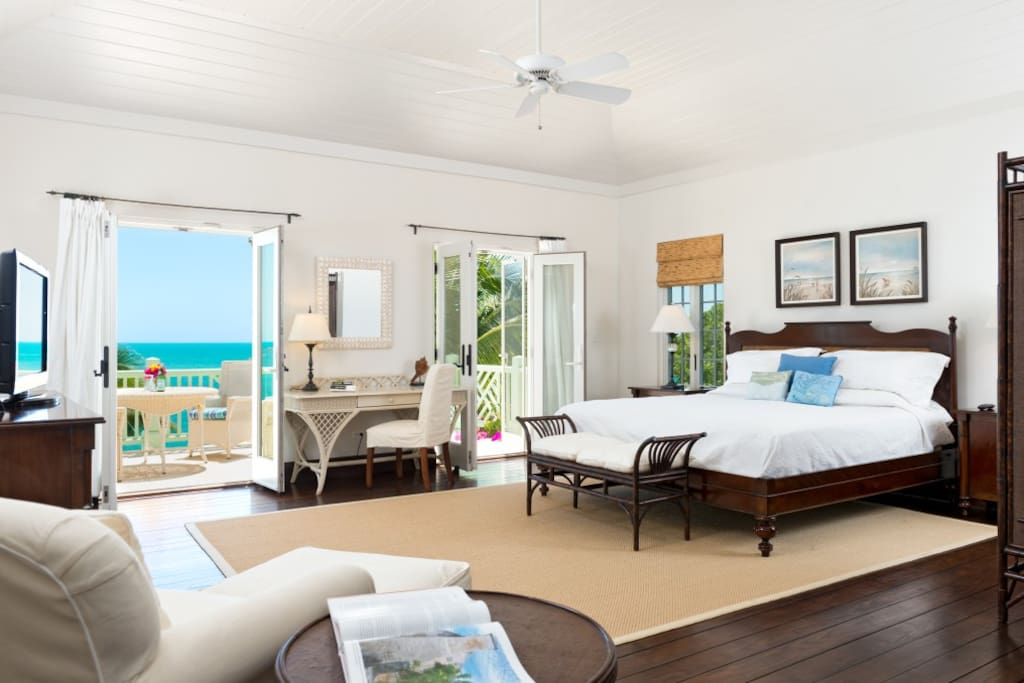 Master Suite (upper): King Bed with great ocean views, en suite full bathroom, separate jacuzzi tub and shower, double sinks, TV, Air Conditioning, private deck with ocean view, custom trayed tongue and groove ceilings, fine furnishings and wood floors.