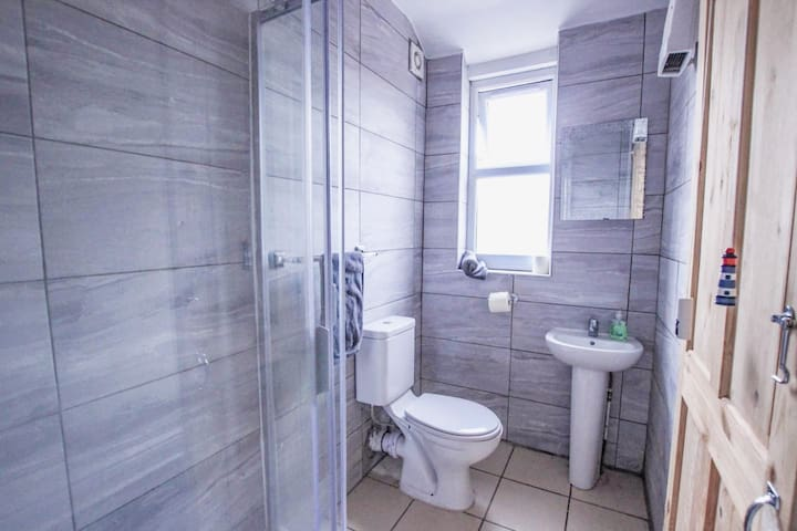 Shared bathroom with free Shampoo/body shower/conditioner and towels.