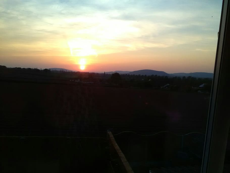 View from bedroom window, sun set over the mountains