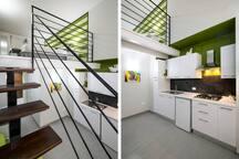 Vista camera su soppalco e cucina
