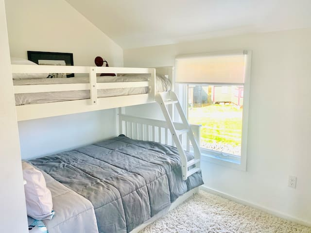 Bedroom on the second floor with bunk trundle bed. Full and 2 twins ( one roll out)