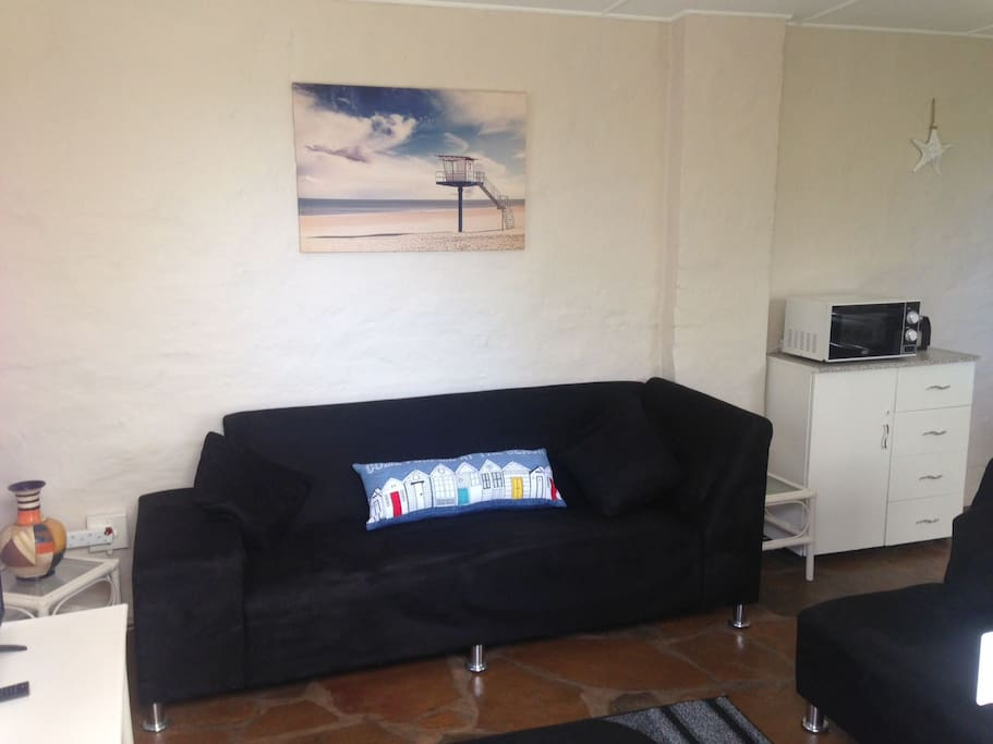 Open plan lounge with DSTV and fully kitted out Kitchen
