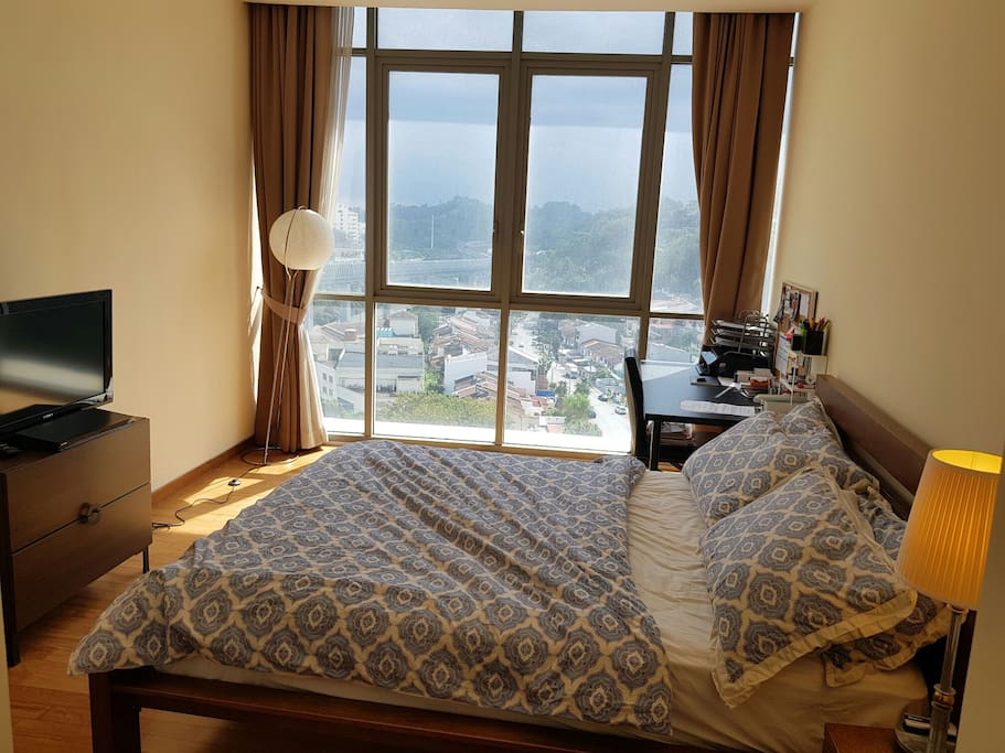 Master's Bedroom with queen size bed with TV and chromecast-ready. This bedroom is available for use for 4 guests and above only.   Great view of the city too!