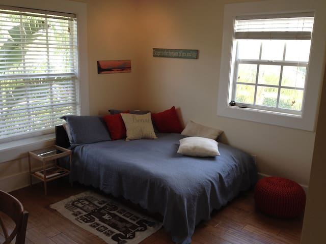 Newly renovated room with  hardwood floors and modern FULL size bed.