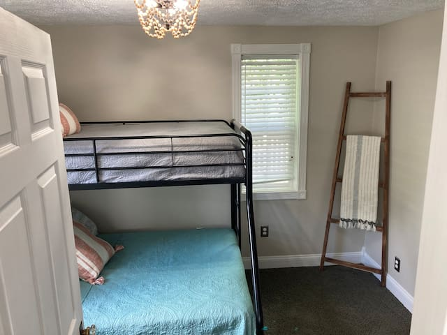 Bedroom with twin over full bunks.