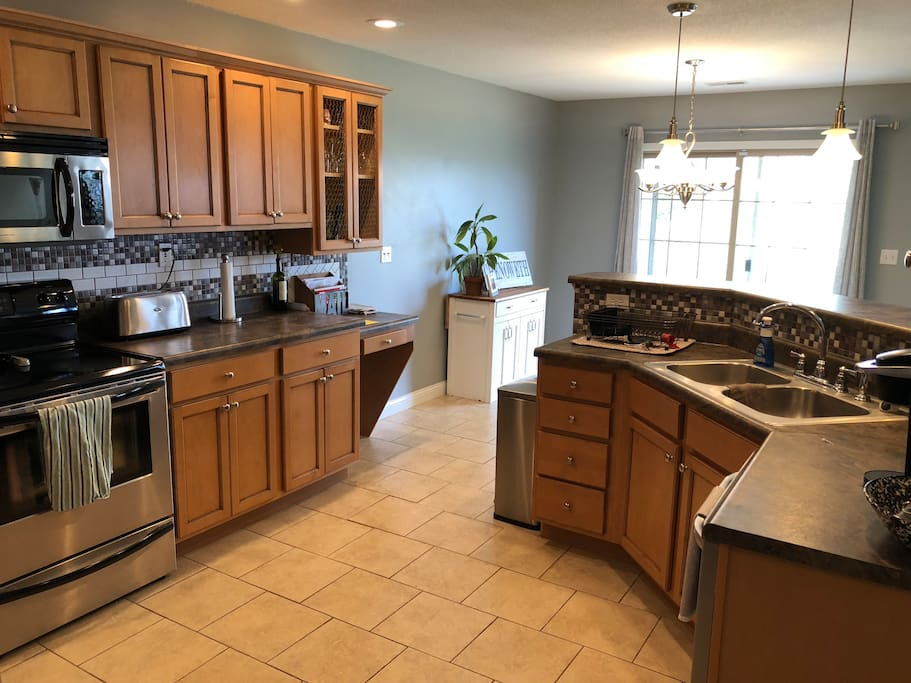 Spacious, fully stocked kitchen. Plenty of pots, pans, plates, bowls, utensils, spices and condiments. Oven, stove, microwave, fridge, and dishwasher available for your use!
