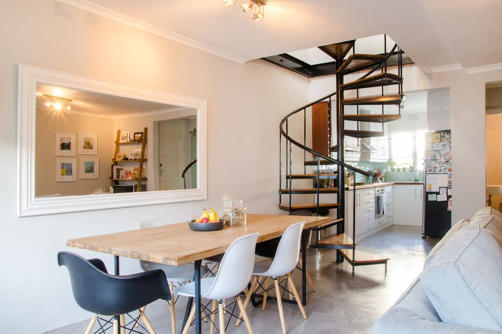 Open plan kitchen, lounge, dining room. Spiral staircase leads to sunny, spacious bedroom.