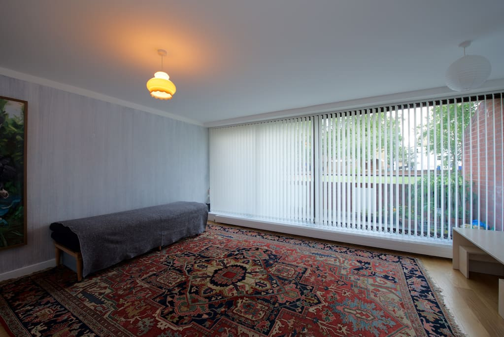 Living room, balcony. Blinds offer shade and privacy. We don't have this rug anymore but a smaller one.