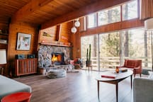 The living room is large and open with so much room for activities. The two story wall of windows looks out into the trees. It's not called Big Bear Treehouse for nothing! The living room has brand new wood floors.