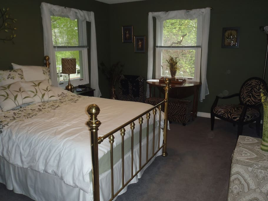 The Sage Room, queen bed,  overlooks the Rock Garden, table, chair, bench, bedside dressers,  large closet. Shares Lounge & washroom