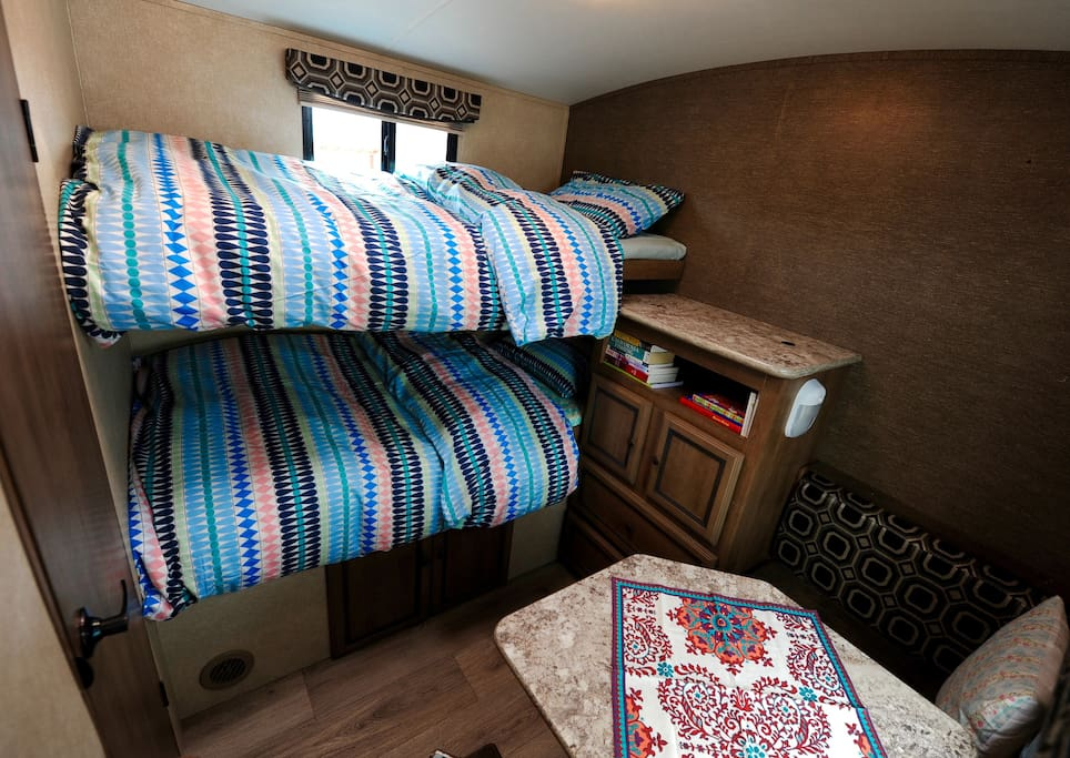 Rear bedroom with adult-size twin bunks and small kid bunk