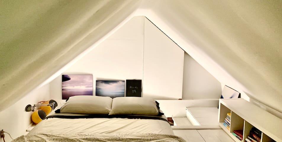 Sleeping Loft on the top floor with queen size bed