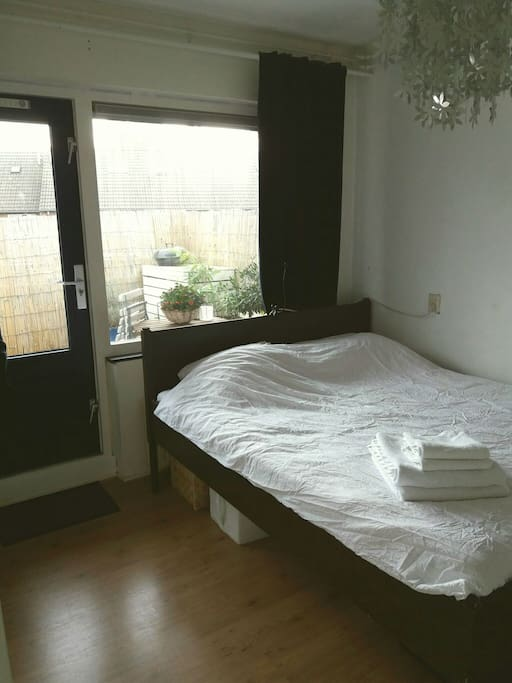 The bedroom with entry to the balcony and bathroom