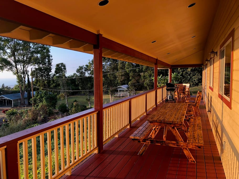 Extra-long lanai with BBQ grill, picnic table and chairs, perfect for relaxing and taking in the beautiful ocean view & sunsets.