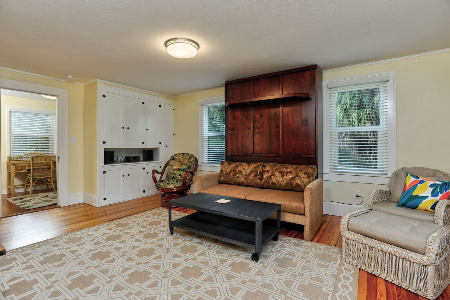 Bright, sunny, comfortable and immaculate main room with original 1920's cabinetry and refinished original heart of pine flooring throughout the apartment.