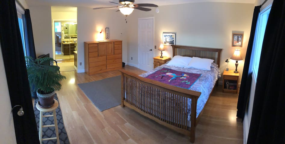 Private master suite and adjoining private bath.