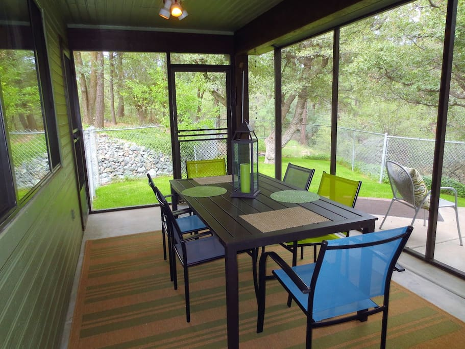 Screened Back Patio with Table, Chairs and View