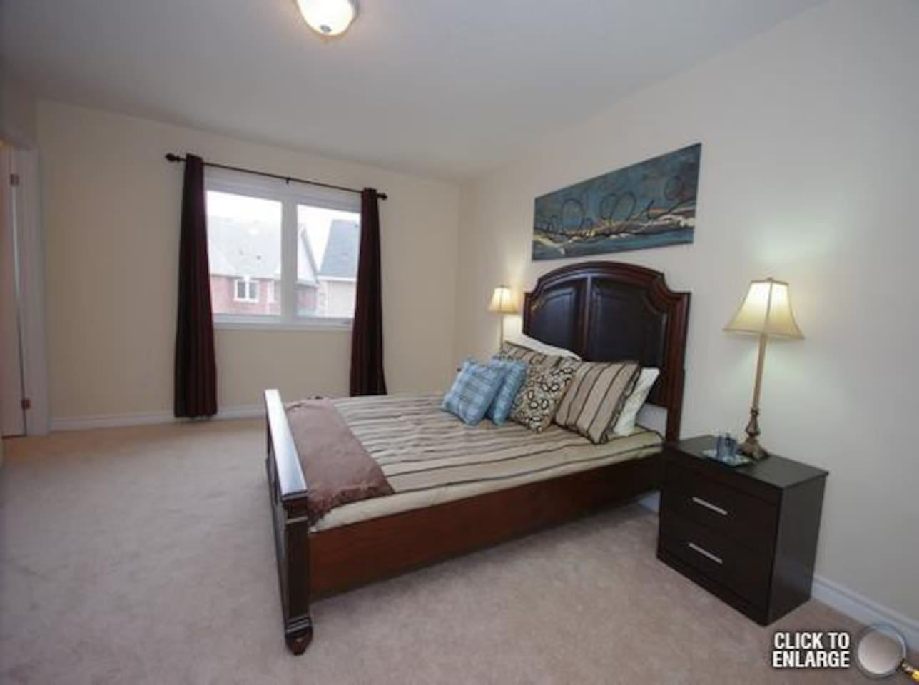 king size bed in master bedroom upstairs with ensuite