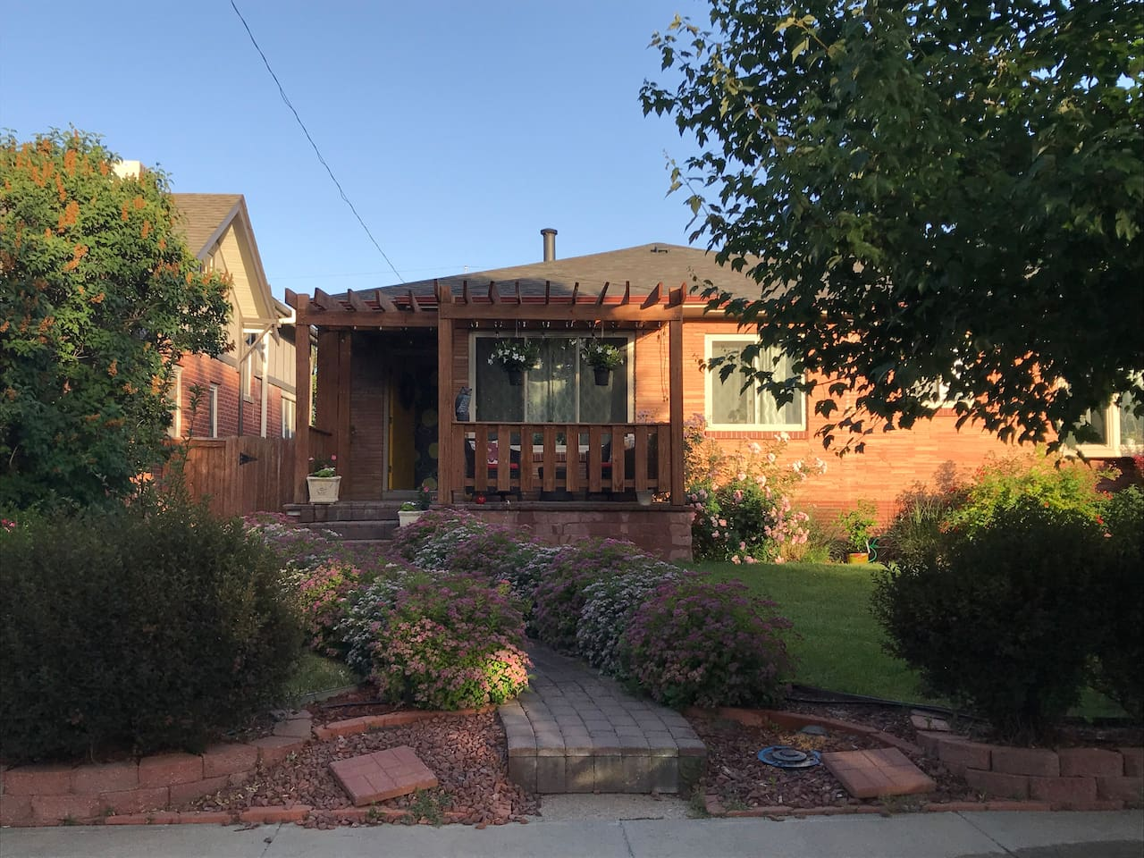 Welcome to our home!  A quiet street in one of Denver's most desirable old neighborhoods.  Safe and fun to walk around!