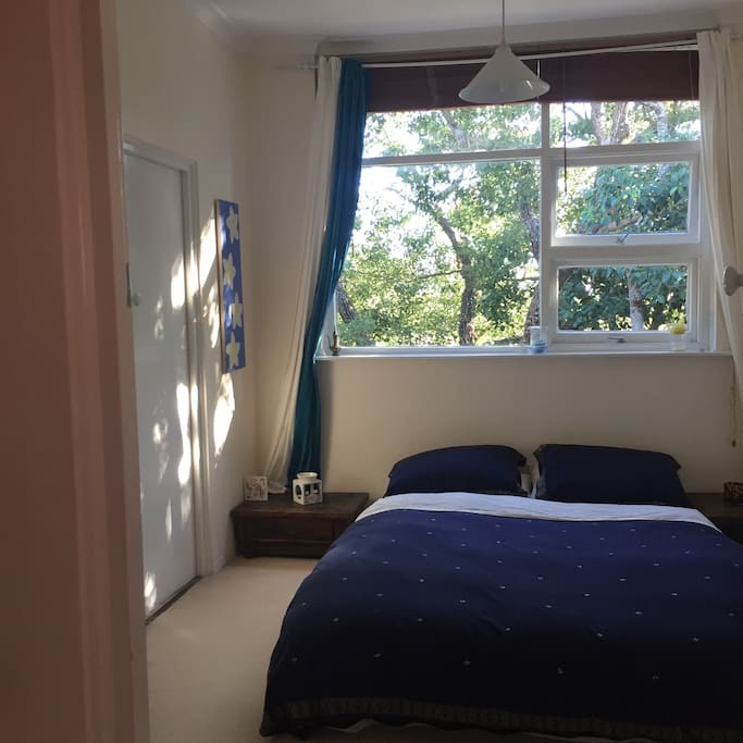 Bedroom. Very cosy, slightly firm queen size mattress on floor. Mattress has wool mattress protector for extra warmth. There is a heater & hot water bottle too. You can access the bathroom from this room as well.