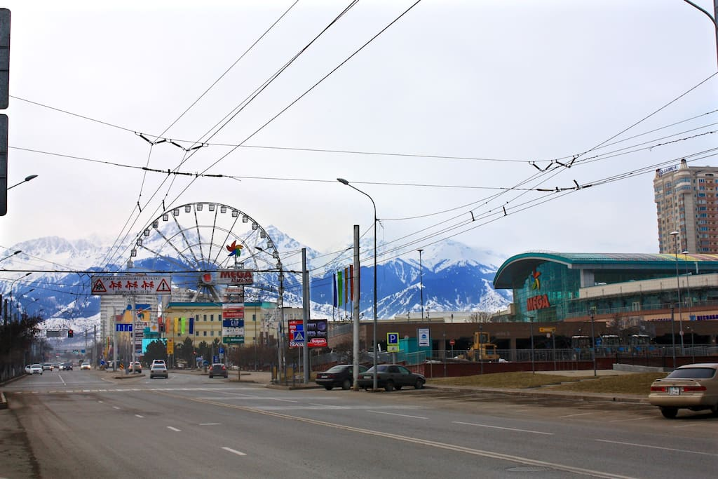 Early in the morning. Across the street located a one of the biggest shopping mall in Almaty - MEGA Alma-ata (boutiques, restaurants, cafes and supermarket) and a panoramic wheel.