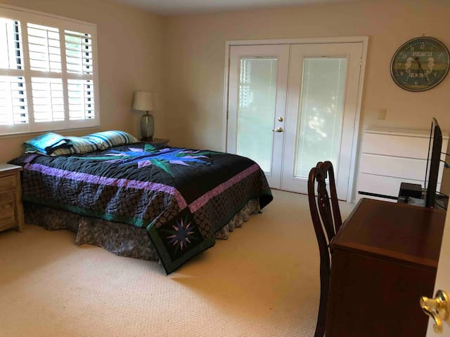 Private bedroom that has French door that opens to the back yard garden