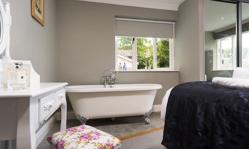Ground floor room  with freestanding bath. Light, cosy and calm