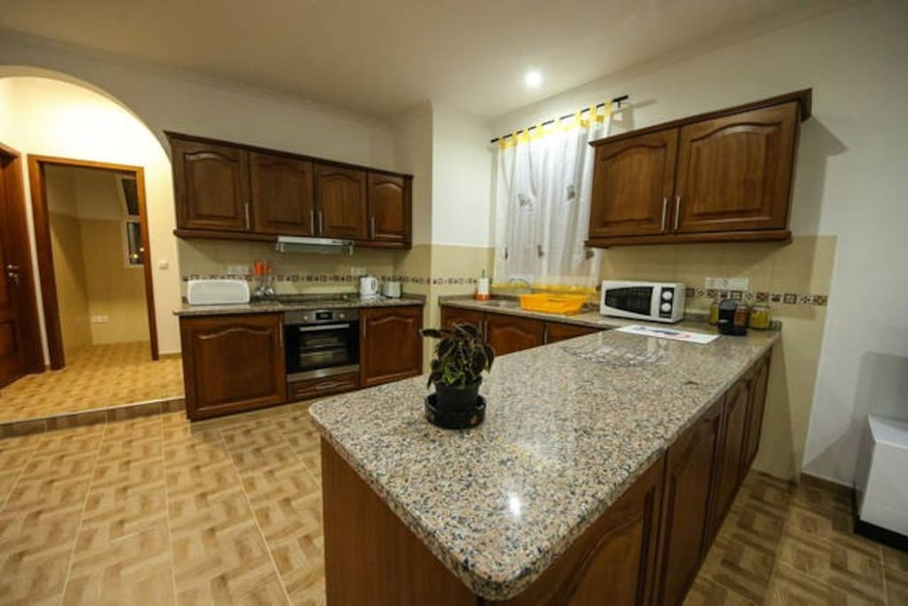 Fully equiped kitchen (oven, stove, microwave, dishes and cutlery and other cooking appliances).