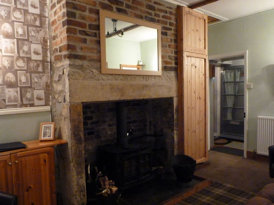 Lounge has an open hearth with log burner and coal-fired central heating (radiators in all rooms); additional electric radiators for extra warmth in winter.