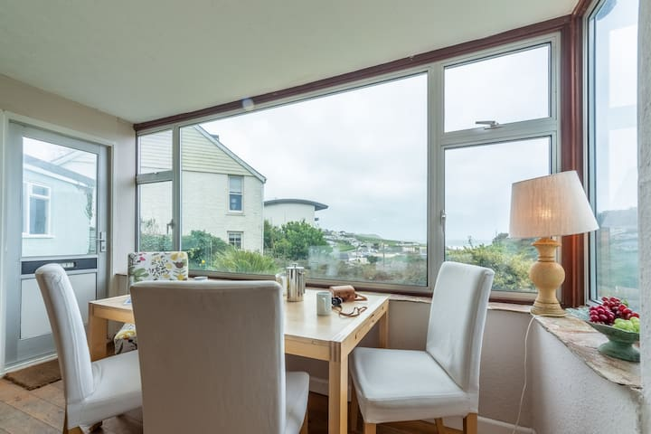 The best table in the house! Enjoy views over the village and Polzeath beach as you dine