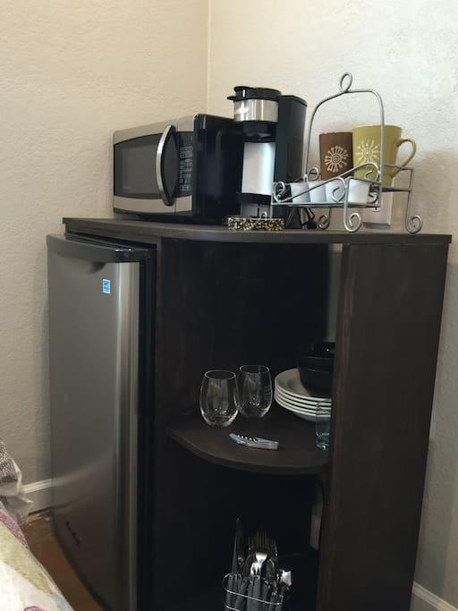 Brand new fridge, microwave, and one cup coffee brewer.