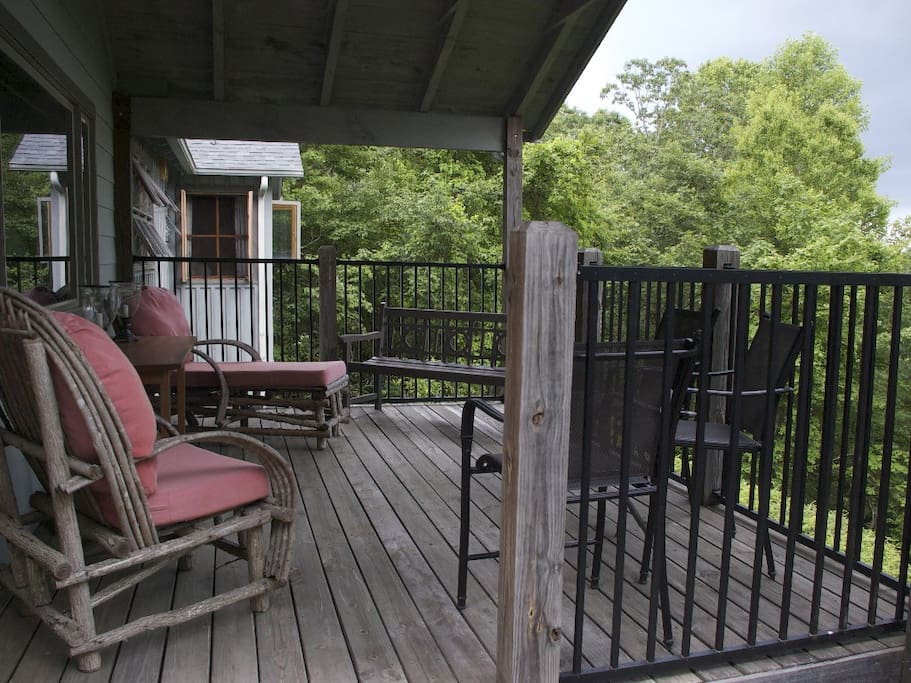 The back porch sits 30 ft off the ground looking over the beautiful mountains