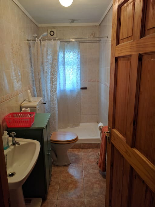 Private bathroom with an electric shower.