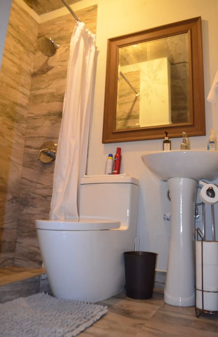 Bathroom with shampoo, towels, paper, handsoup and hand cream
