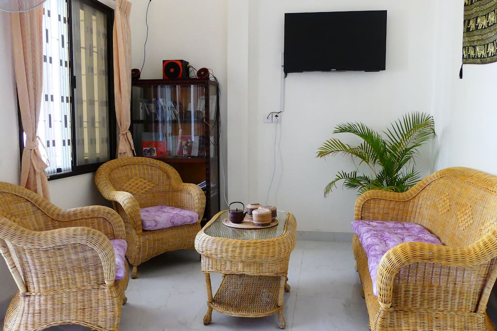 This is the living room, where you can spend some time listening to music and watching TV; we have many TV channels, in many languages.