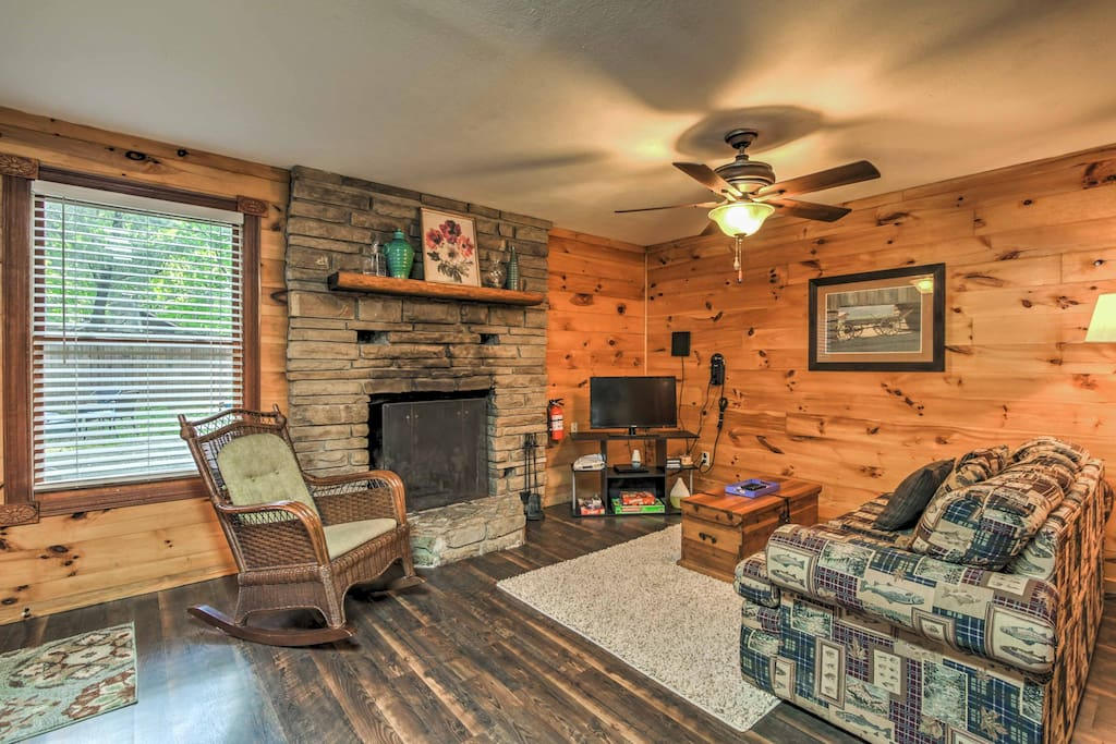 Step inside where hardwood floors, wood paneling, and rustic decor await.