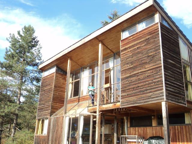 Chambre dans maison en bois, bioclimatique