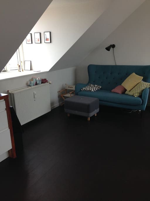 the living room, TV and couch