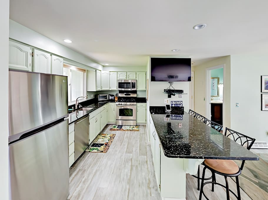 The chef of the group will appreciate the modern kitchen equipped with a flat screen TV.