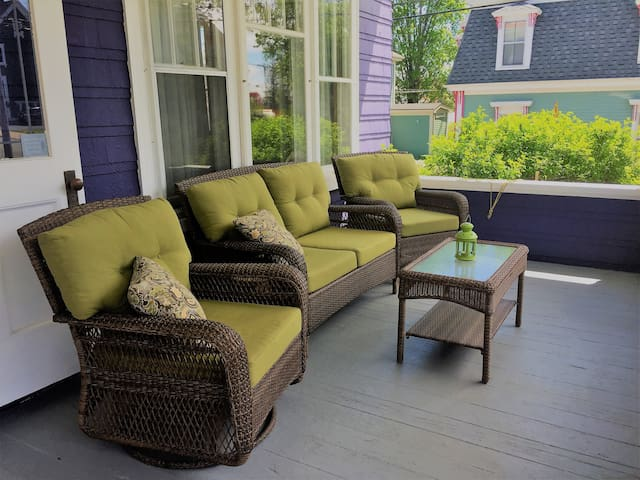 Comfy seating on the verandah for guests to relax and enjoy after a day of exploring.