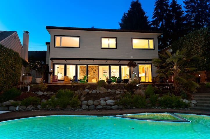 Back of the house has a full private deck, outdoor living furniture, bar-b-q, and heated pool. Bedrooms are all on the top floor of the house. Expansive views from the deck to English Bay.