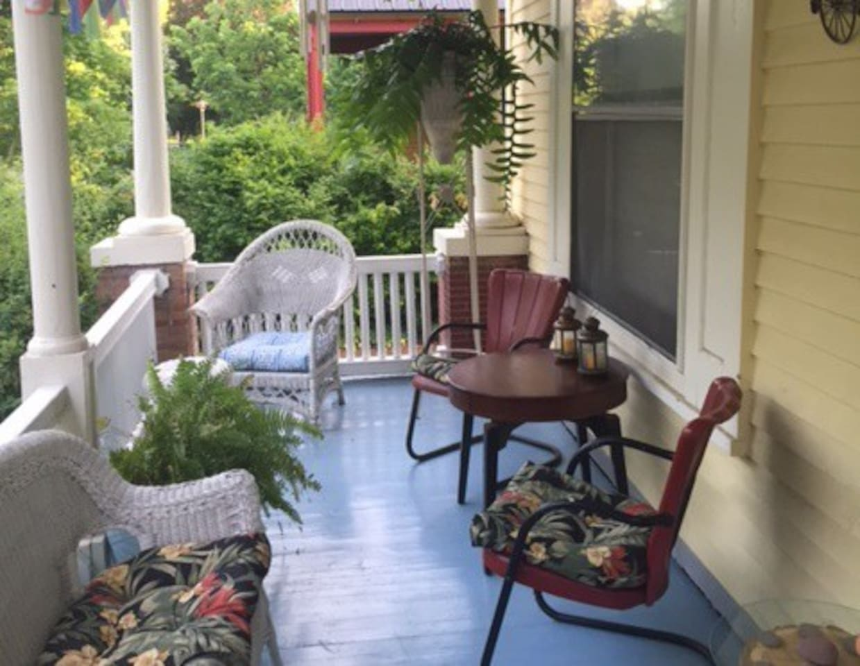 Comfortable porch with seating for 6. Drenched with sun in the morning