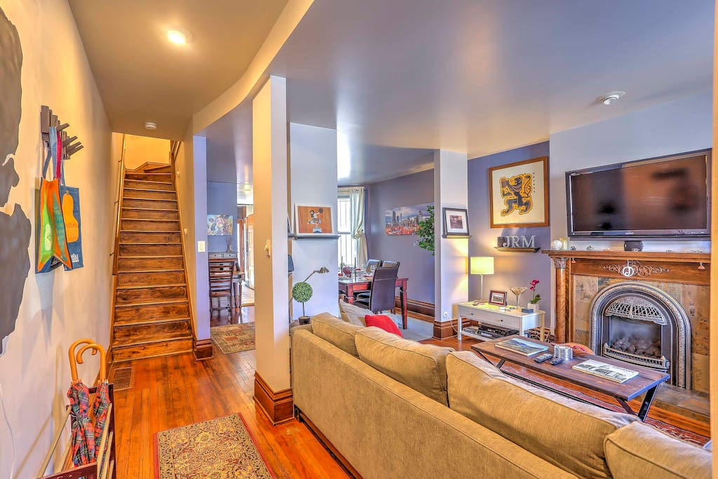 An open-concept layout, gas-burning fireplace, and beautiful hardwood floors make this home warm and inviting.