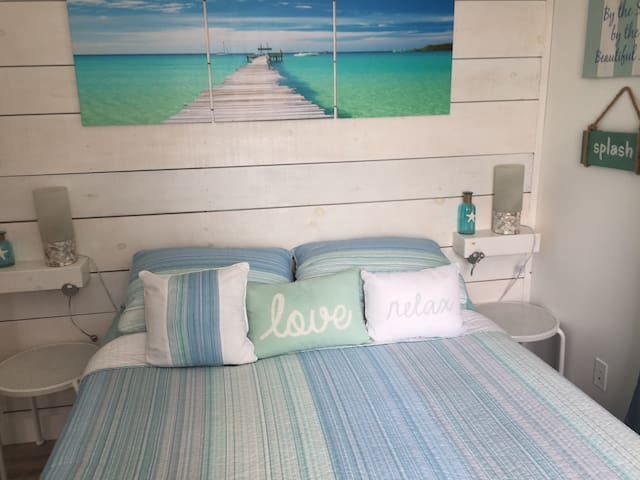 Master bedroom with queen bed and a great water view