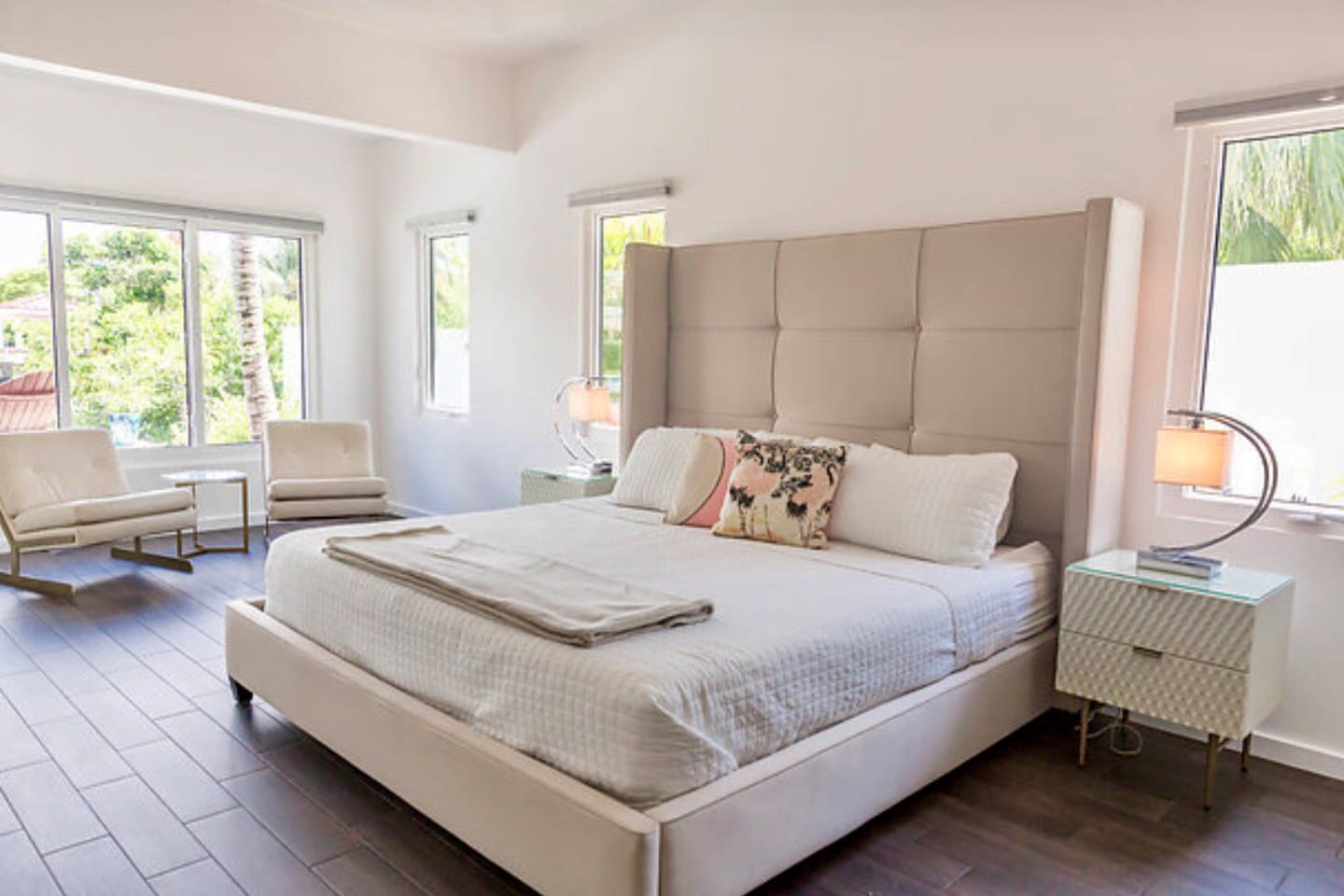 Master Bedroom with king bed and door leading to pool and Jacuzzi
