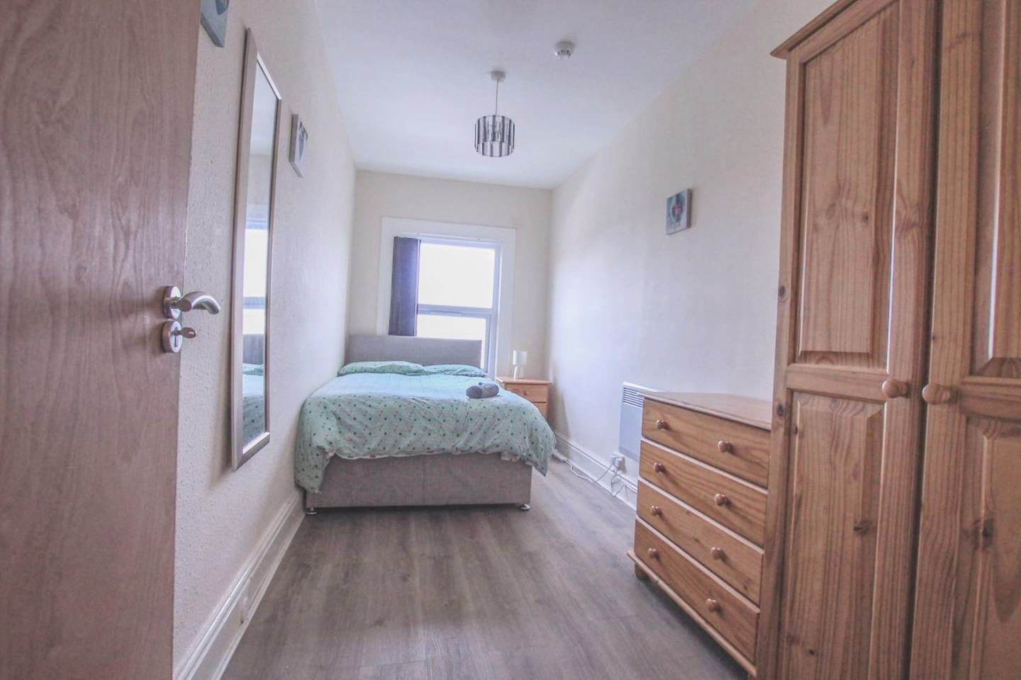 Private small bedroom with shared bathroom, living room and kitchen. Double bed ideal for a couple or single person.  Room number A3 with Chester drawer, night table, wardrobe, table and chair + Free towels/Shampoo/Tea/coffee/sugar/salt/pepper/oil.