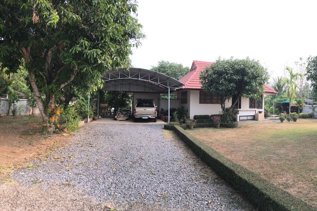 Charming in front of garden house, and have one small house inside near the river. Your family or your group can live here like homestay. Exercise and walk around the garden, especially have big good breath in the morning or evening after the sun set. Let's relax and spend your holiday here. You will be unforgettable and definitely get fresh breath before get back to your routine work!